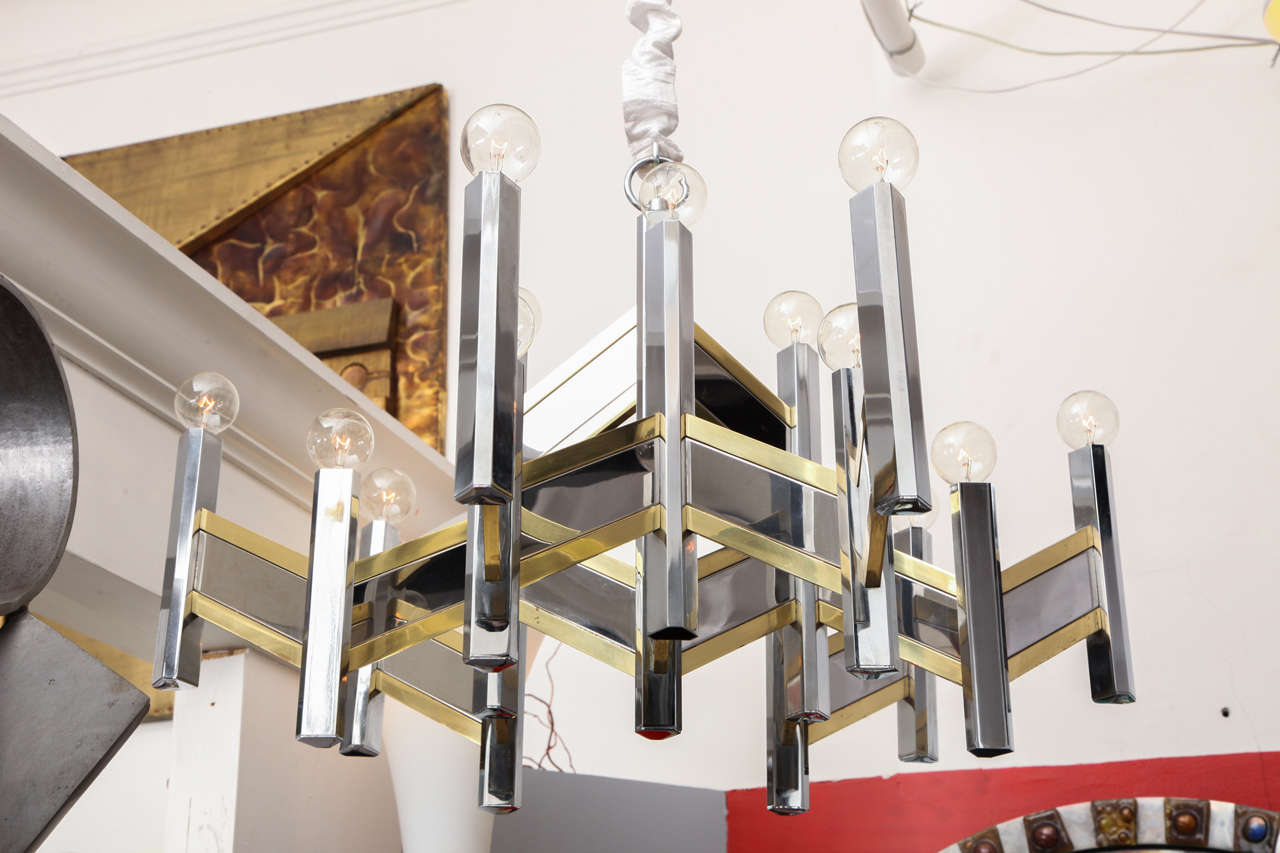 An Italian 1960s architectural ceiling fixture by Gaetano Sciolari, the architectural form crafted of polished nickel and brass.  10492