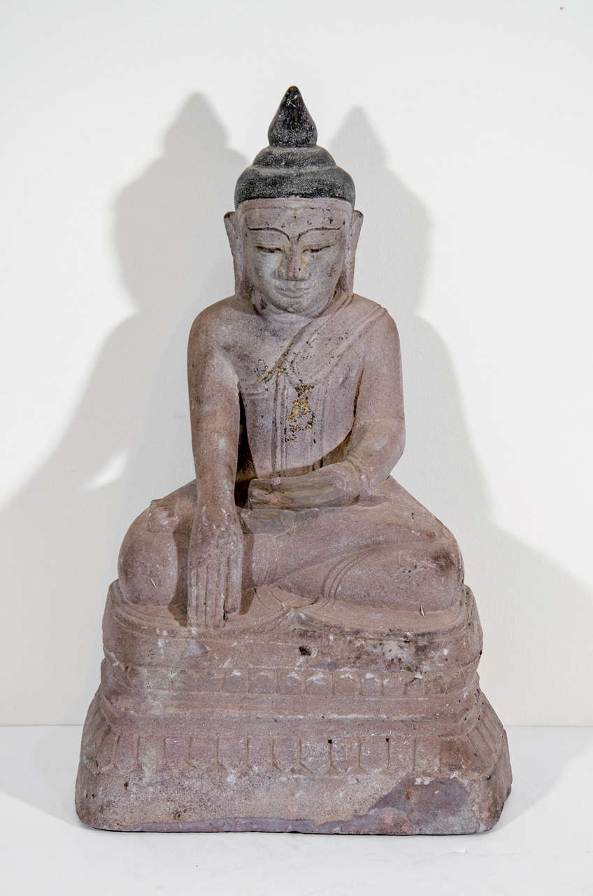 A nicely carved Burmese sandstone Buddha sitting in the Bhumisparsa mudra position (calling earth to witness), Burma, circa 1800.