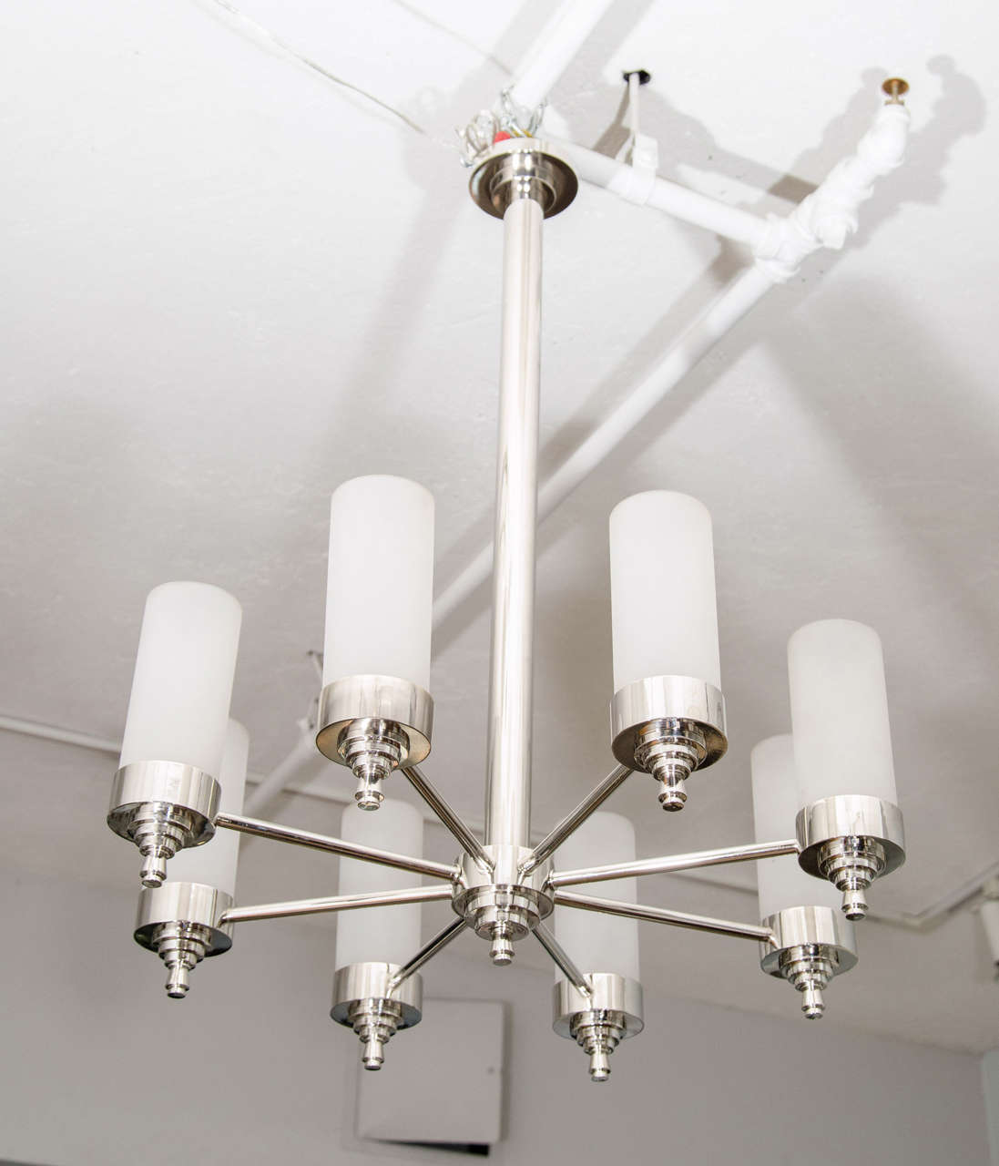Elegantly detailed French chandelier designed by Jacques Adnet for Petitot, nickel plated with original frosted glass shades.