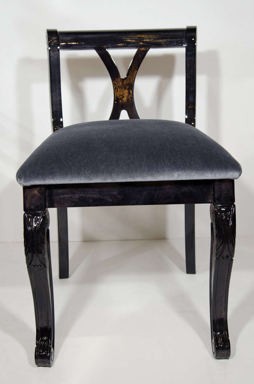 Elegant Art Deco era vanity stool or side chair, in ebonized walnut wood with charcoal gray mohair.  Low back design with cabriole legs with hand-carved details.  Also features beautiful curved cross back with X-form. Two stools available and sold