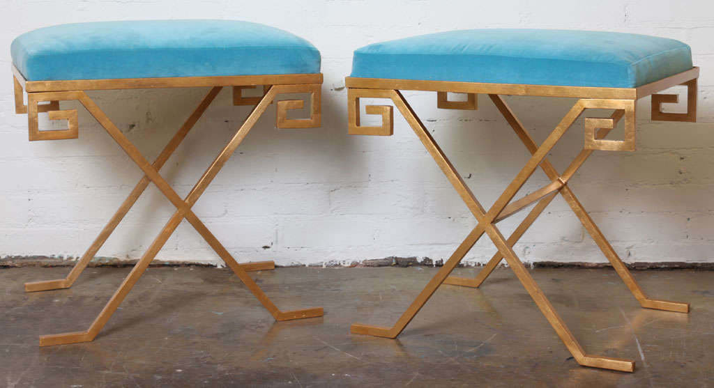 Greek key stools with gold leaf finish and blue velvet cushions.