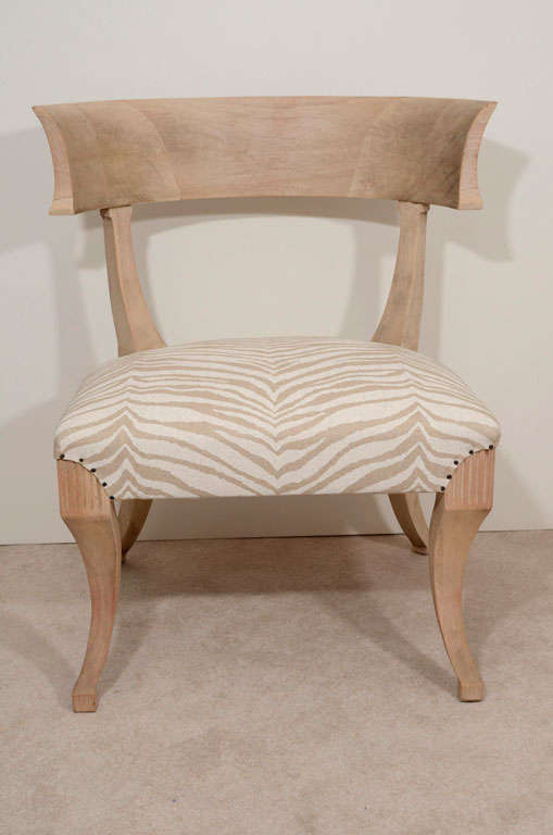 Fabulous animal print linen over a sun bleached mahogany frame. Wonderful curvature with sculpted carved wood details.