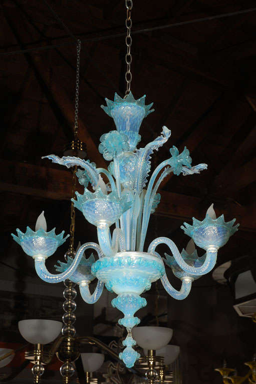 A beautiful Murano glass chandelier from the 1950's. Has five arms and is  decorated with - Vintage Light Blue And Clear Murano Glass Chandelier At 1stdibs