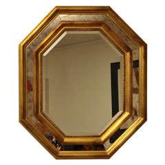 Impressive gilded hexagonal mirror