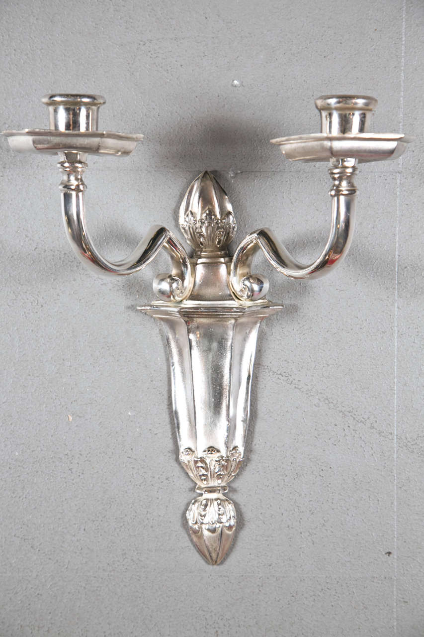 8 pair of Caldwell double light sconces circa 1900. Priced per pair.