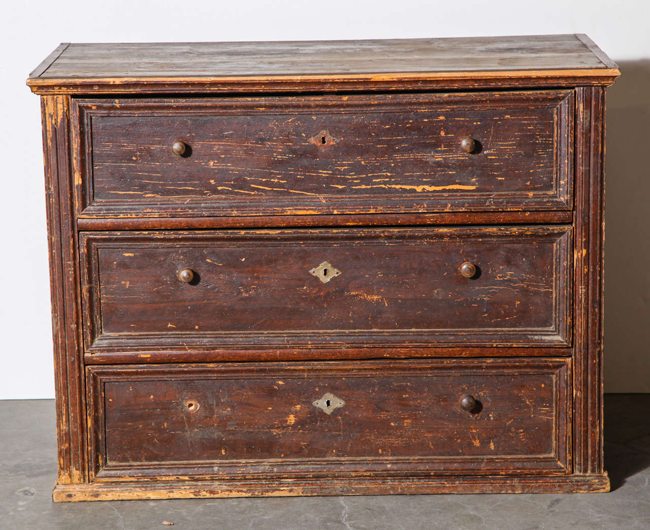 Large chest of drawers made in Belgium in the 19th century. Distressed but all drawers function. Original key included.