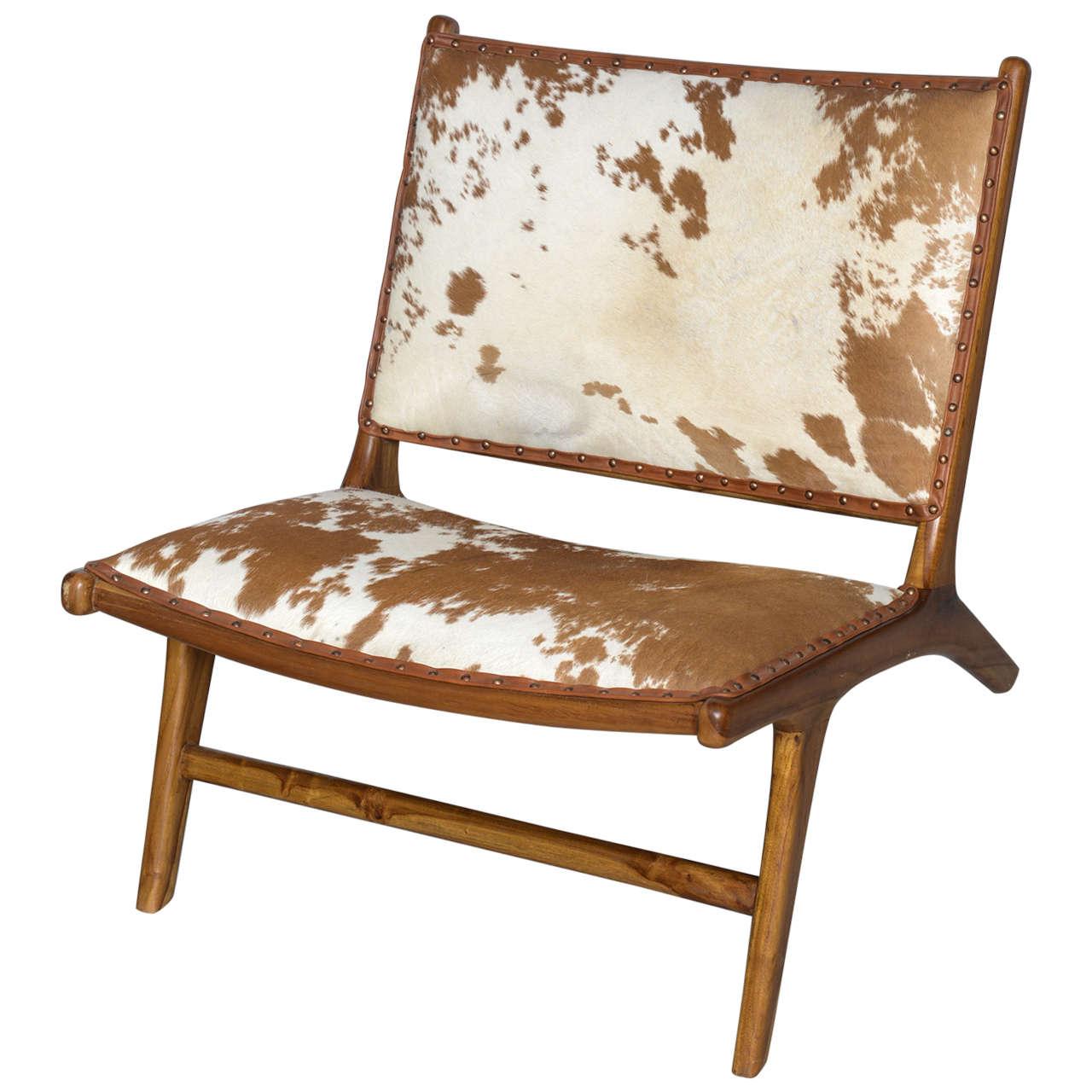 the hampton chair in handmade teak and cowhide at stdibs - the hampton chair in handmade teak and cowhide