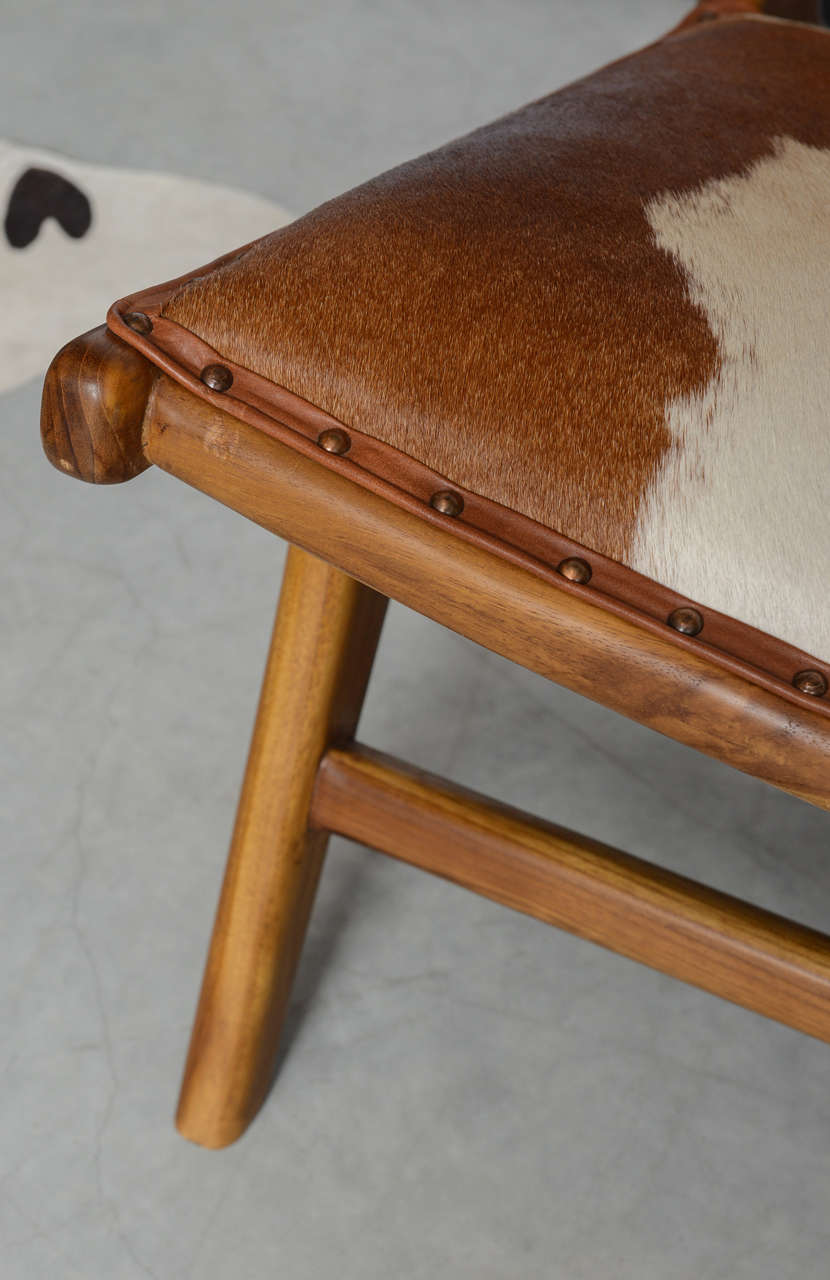 Cowhide Upholstered Teak Lounge Chair In Excellent Condition For Sale In Miami, Miami Design District, FL