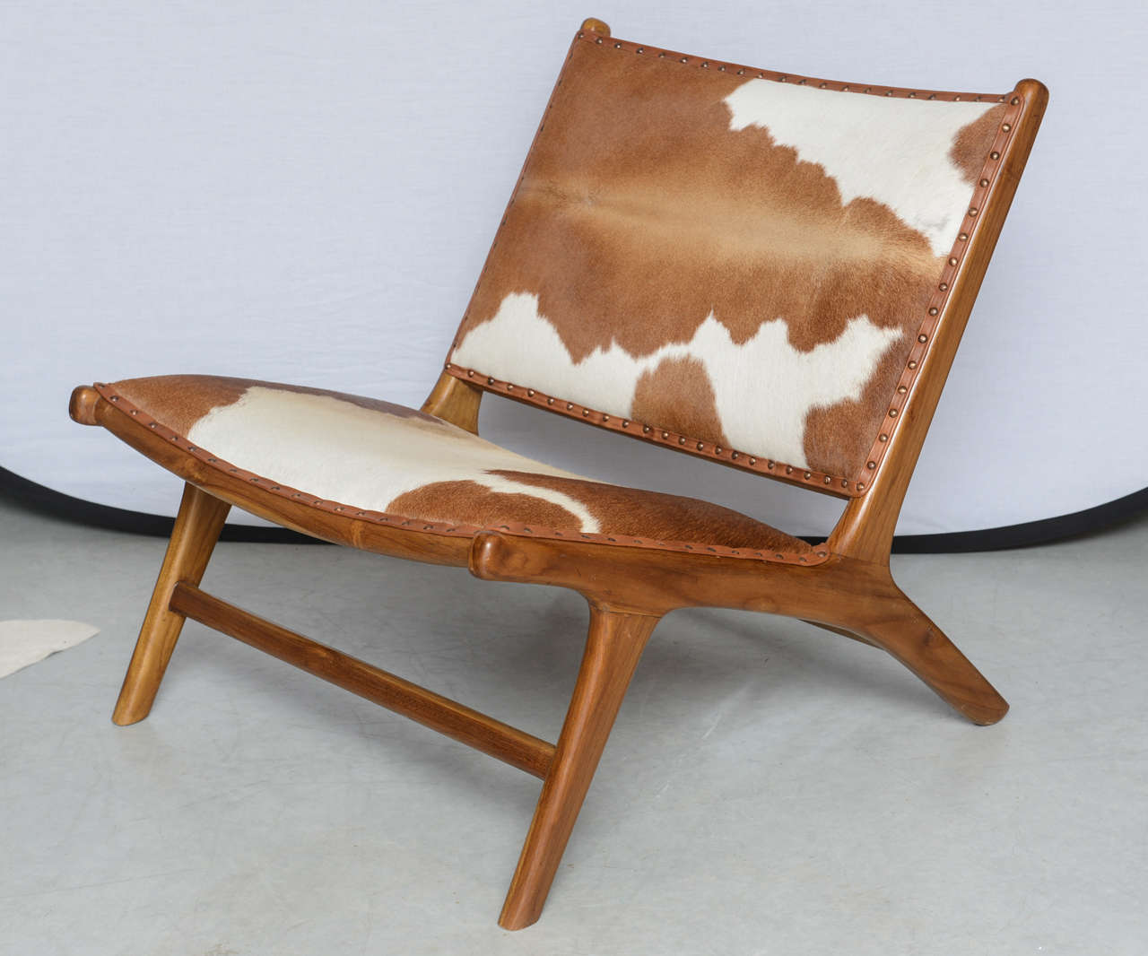 20th Century Cowhide Upholstered Teak Lounge Chair For Sale