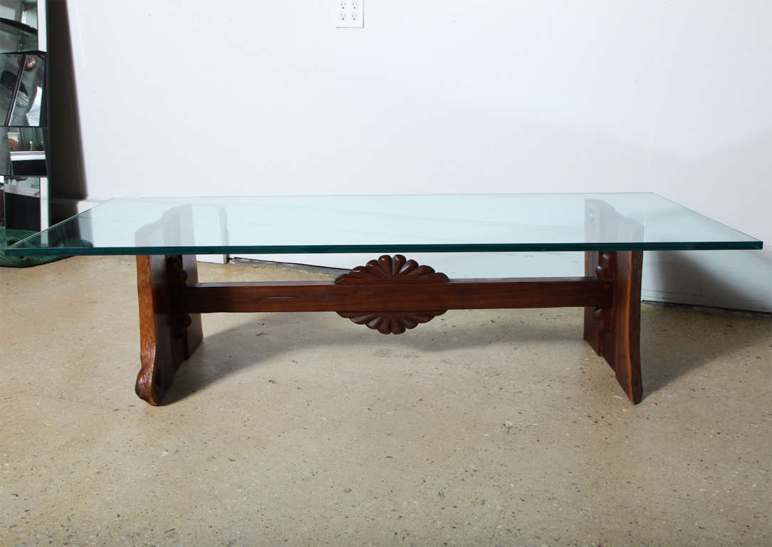 Substantial Phillip Lloyd Powell Black Walnut, Cherry and Glass Cocktail Coffee Table, 1960's. Featuring a hand crafted Black Walnut trestle base and solid Cherry with center carved rosette and natural trestle end supports. Wooden base utilizes