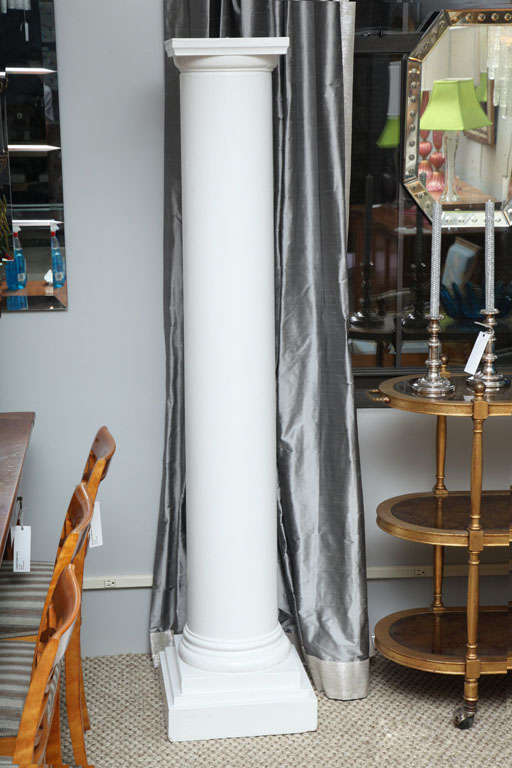 A pair of painted wood architectural columns--perfect as room dividers or as pedestals.