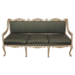 Antique French painted and carved settee. Louis XV style.