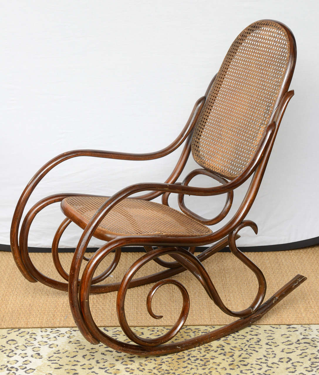 Austria, 20th Century Charming Rocking Chair In Wood With Cane Back And  Seat.