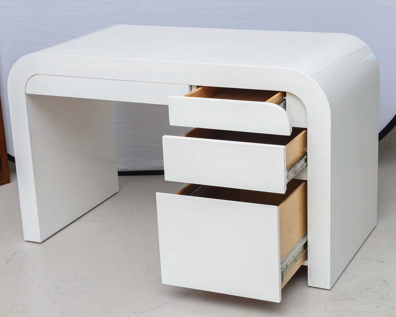 this mid century modern white lacquer desk is no longer available