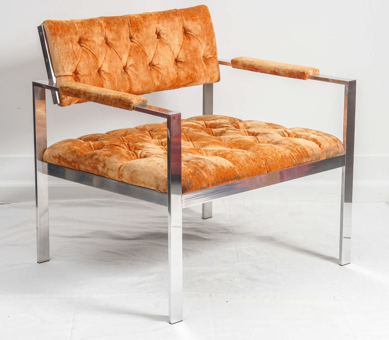 Often found listed as a Harvey Probber aluminum lounge chair and ottoman. The chair is identical to the Probber chair, other than a couple of screws. Its shown in its original orange tufted velvet. The frames are in excellent condition, with a