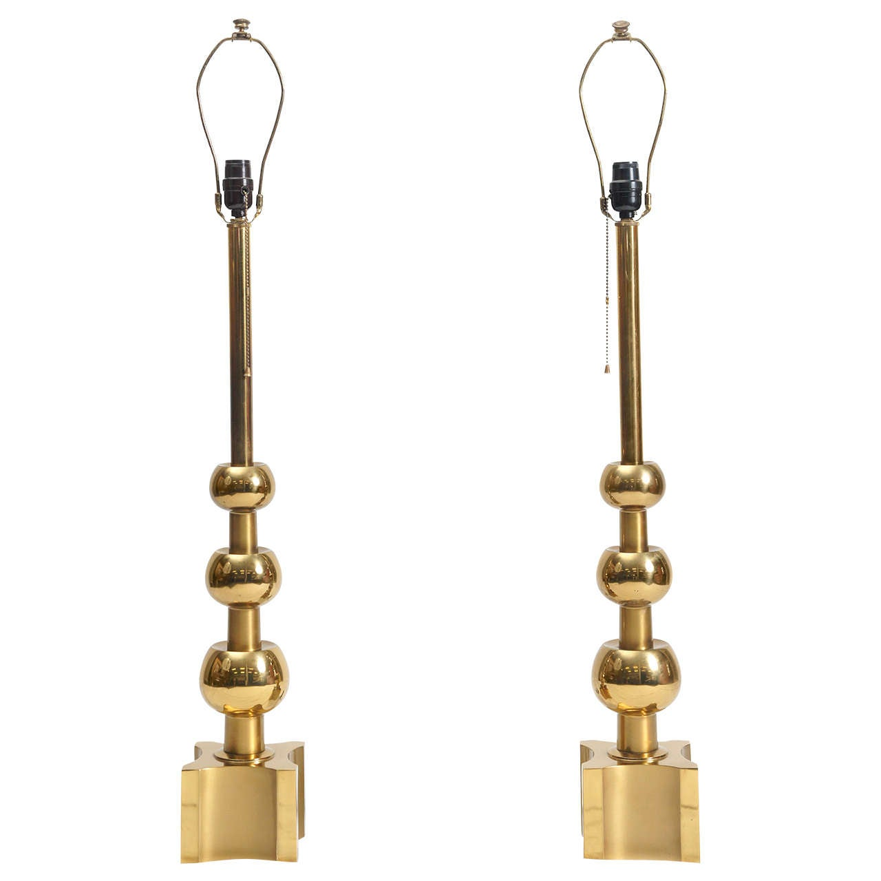 a very tall pair of mid century brass Stiffel table lamps