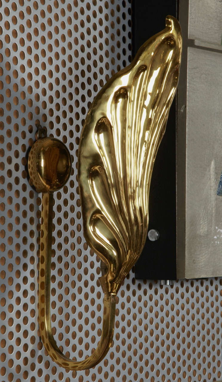Polished brass sconces by Tomasso Barbi.