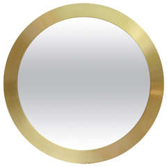 Round Mirror Surrounded with Brass