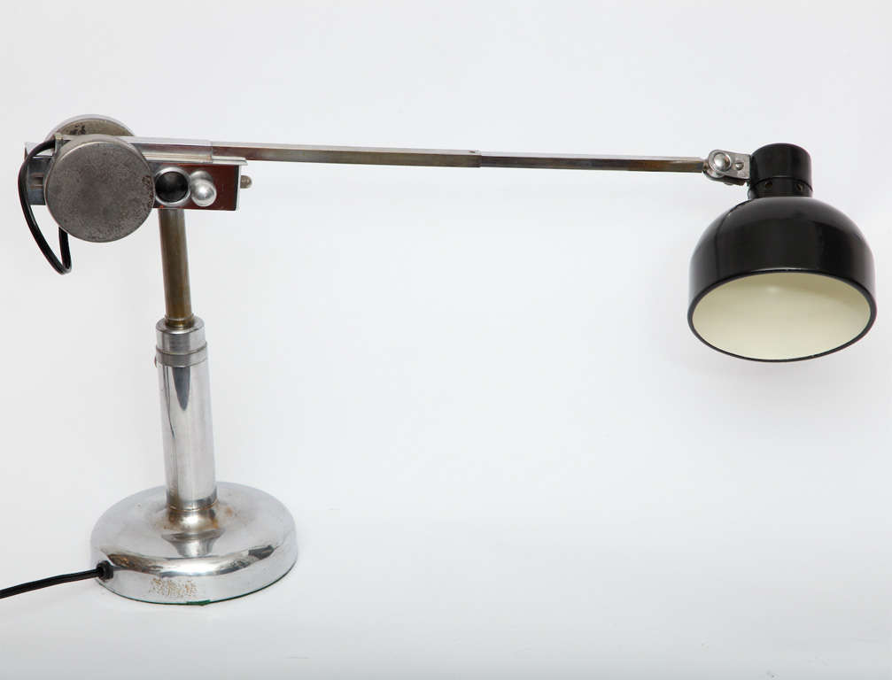 A 1930s French articulated table lamp.