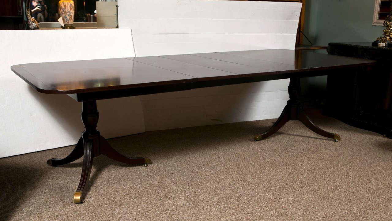 Kindel Mahogany Double Pedestal 4 Leaf Dining Table at 1stdibs : B from 1stdibs.com size 1280 x 722 jpeg 96kB