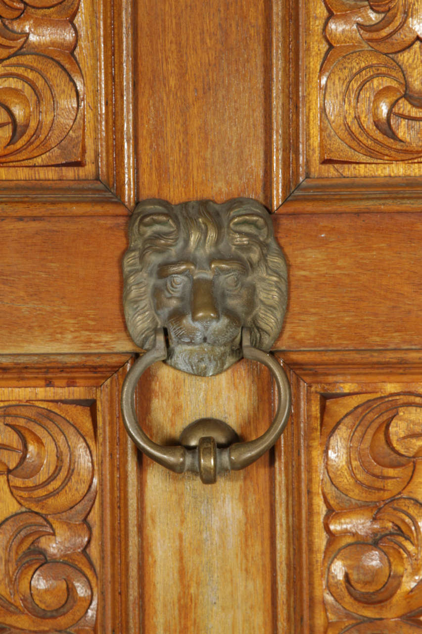 Carved wooden spanish style entry door with bronze