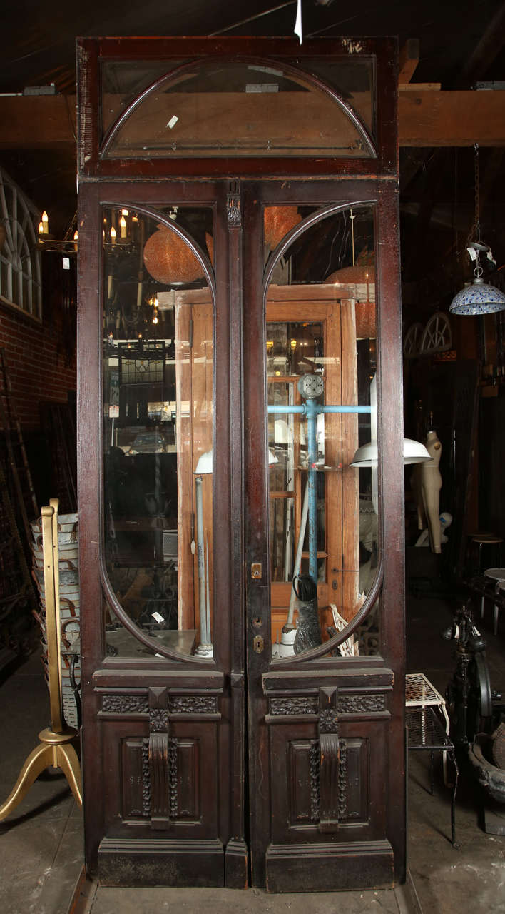 Double Door Set With Matching Transom And Beveled Glass