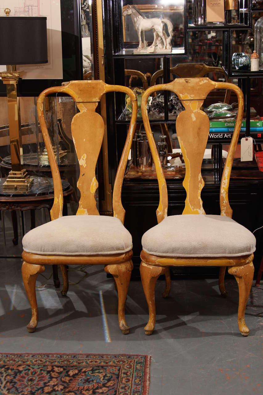 Pair of Mid-Century Phyllis Morris wood chairs with remnants of yellow paint. Great patina with good lines.