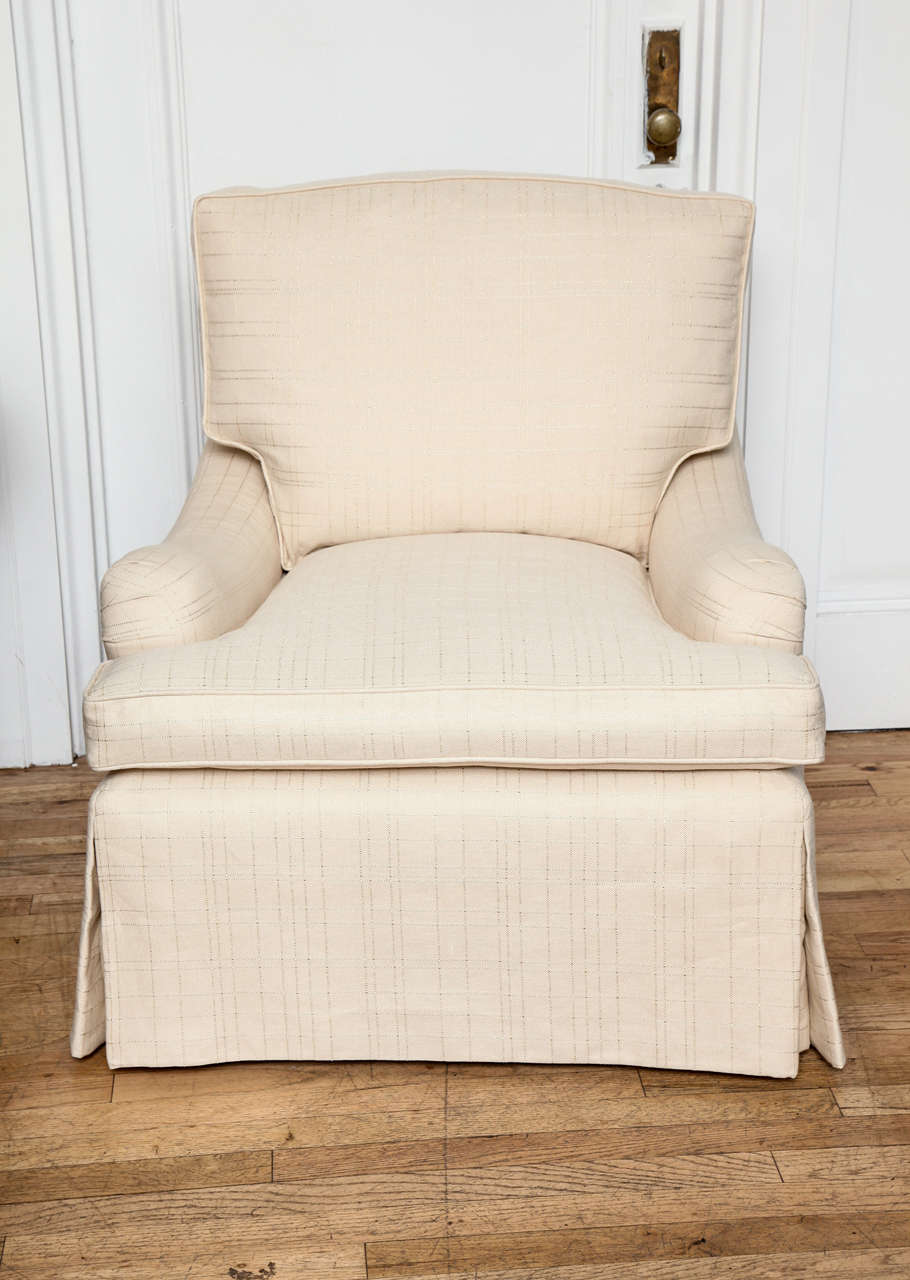 Upholstered swivel arm chair with a dressmaker skirt at for Swivel accent chairs with arms