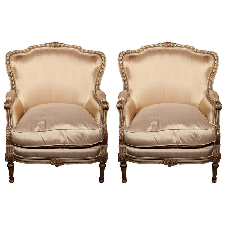 Pair of French Louis XVI Style Bergere Chairs in Fine Painted and Gilt Finish