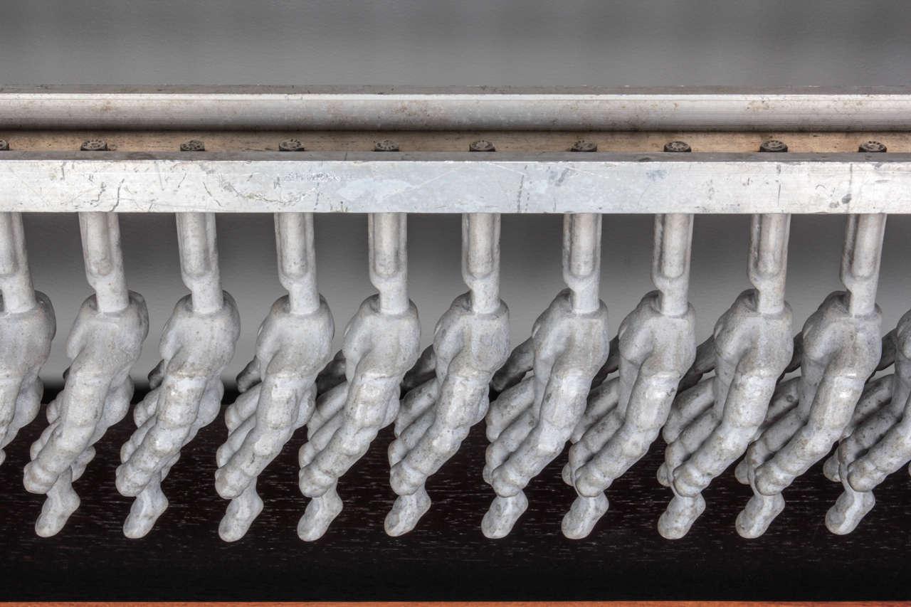 Cast Wood Art : Mid century cast aluminum doll mold sculpture on wood and