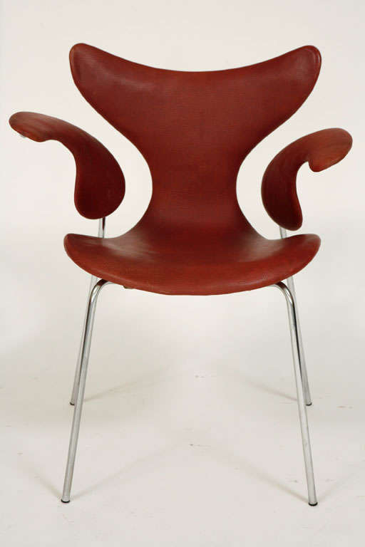 """Original """"Seagull"""" chair design by Arne Jacobsen for Fritz Hansen. Fantastic patina to leather and chrome frame. Beautiful curved lines and a classic. Not a re-issue.  2 available - slightly different color. Priced individually."""