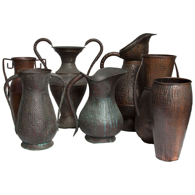 A Set of Seven Italian Arts and Crafts Style Copper Vessels 1