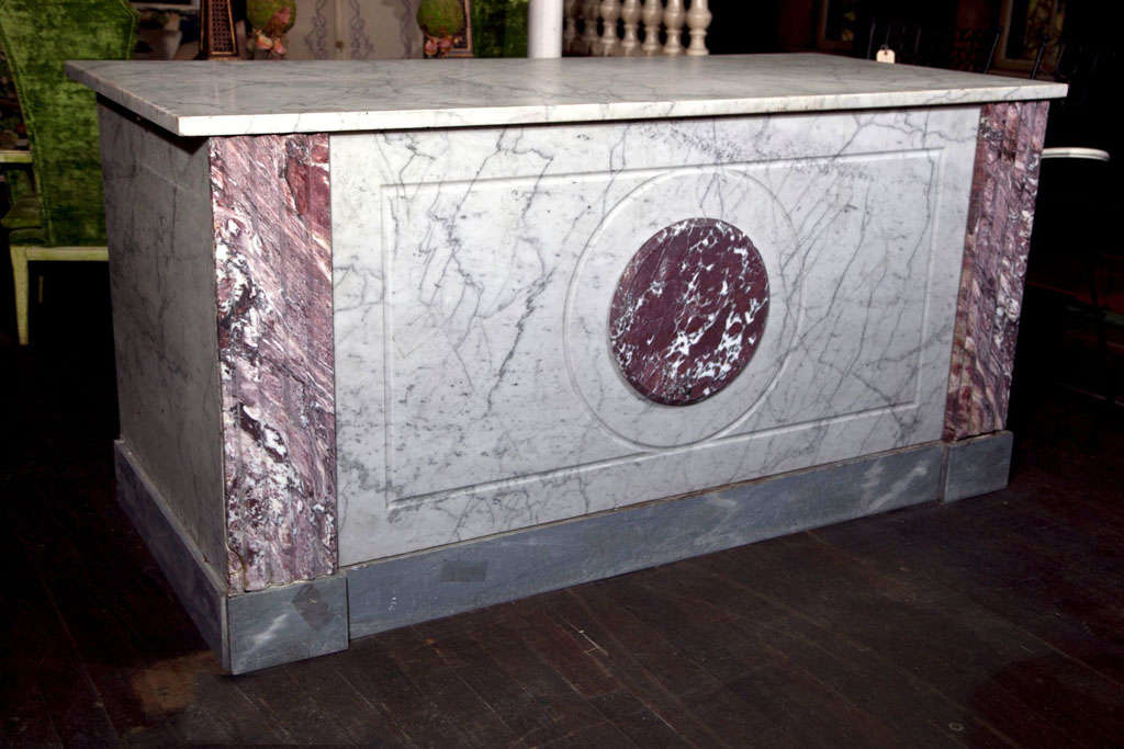 Spectacular carved slab marble counter from a French Boulangerie. This comes with a new wood frame. Actual functioning cabinetry would need to be provided by the buyer.