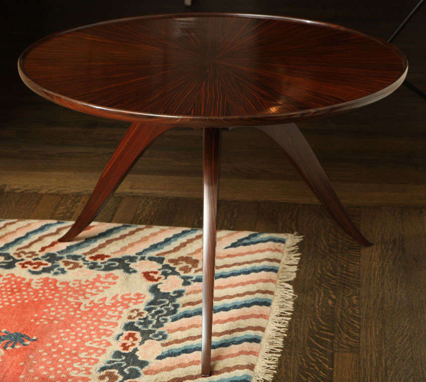 An elegant Macassar ebony tripod table with wood grain pattern radiating from the center on tabletop by Emile Jacques Ruhlmann (1879-1933).  Stamped: Ruhlmann, 1933 & B in a circle (for Atelier B)  Literature: Florence Camard, Ruhlmann: Master