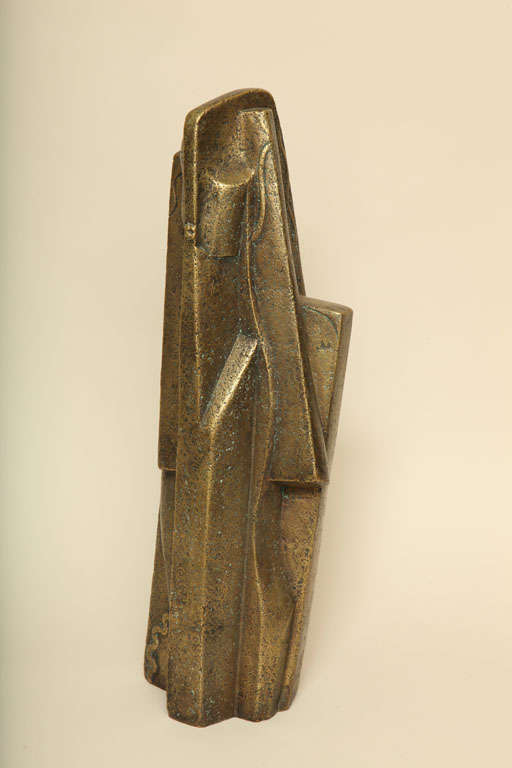Cubistic bronze sculpture of a woman has a gold patina on a rough surface by Joseph Csaky (1888-1971). Conceived 1921; cast at a later date by Susse Fondeur in an edition of 6. Signed: CSAKY 21/ Susse Fondeur Paris with cachet/ E.A. 2/3  Csaky