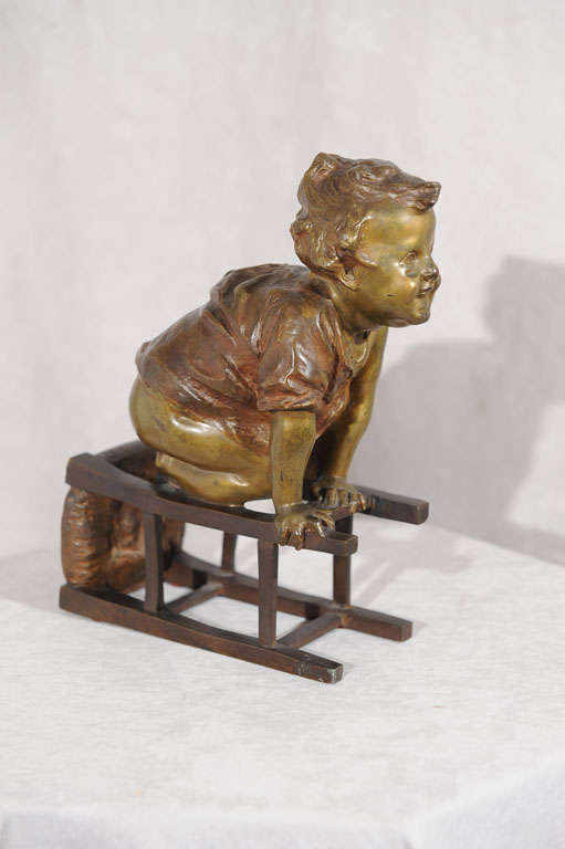 Folk Art Bronze Statue of Toddler Climbing on Chair by Juan Clara ca. 1900 For Sale