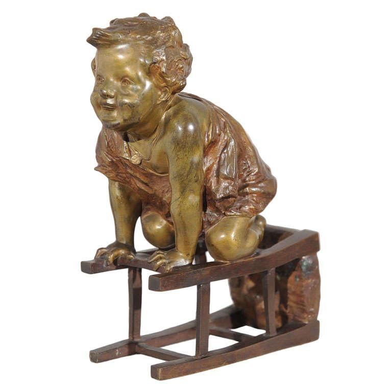 Bronze Statue of Toddler Climbing on Chair by Juan Clara ca. 1900