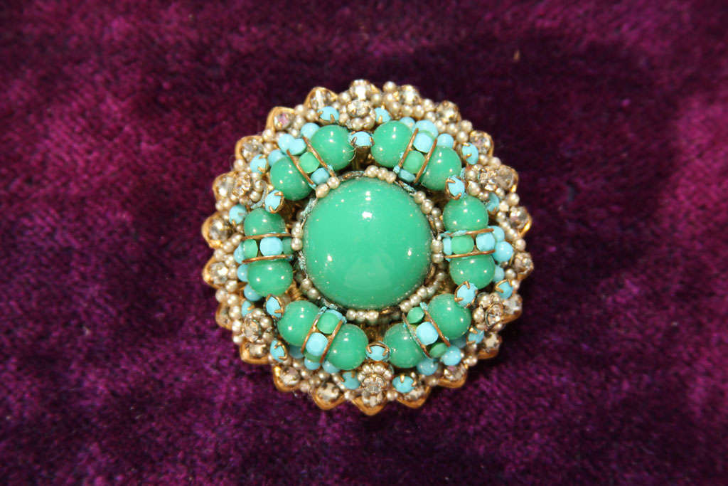 unmarked miriam Haskell pin in blue and green