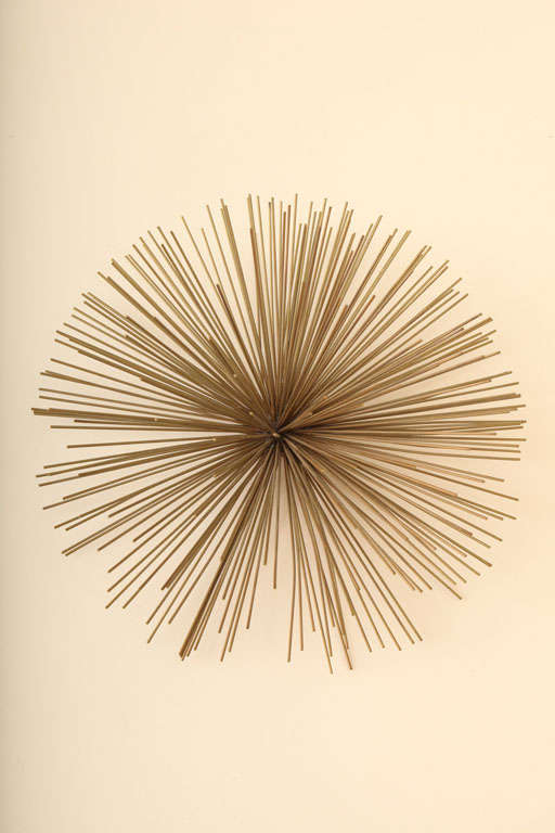 This miniature pom pom  metal sculpture  by Curtis Jere will bring dimension to any wall.