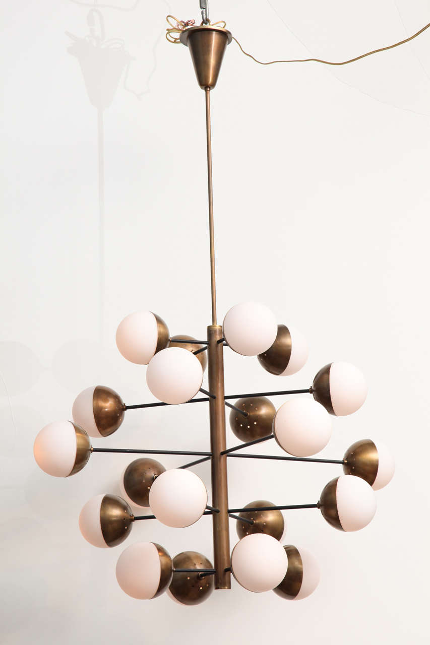Extraordinary, large scale fixture with 20 lights.  Black painted metal, brass, and frosted glass ball shades.  This model is very rare and has a strong presence.