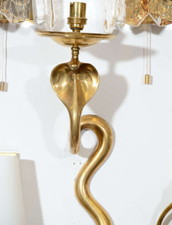 A single vintage French sconce. This solid brass piece is highly sculptural and beautifully shaped into a cobra.