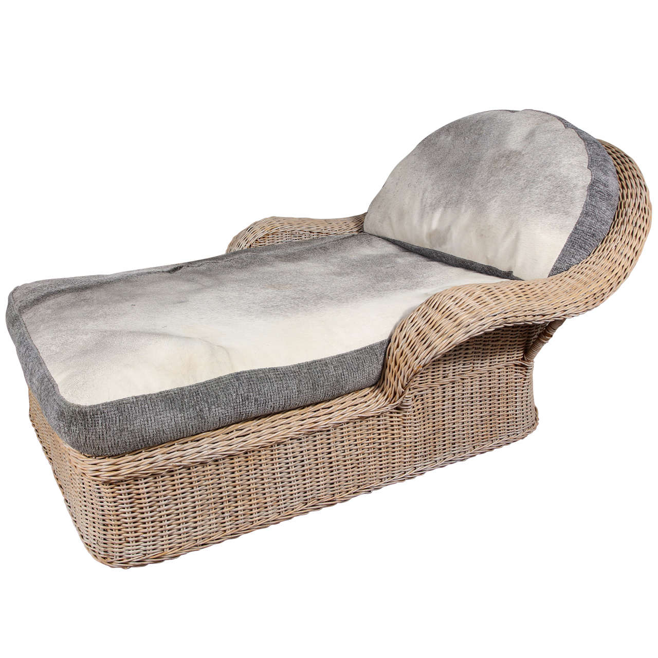 Rattan chaise with cowhide upholstery at 1stdibs