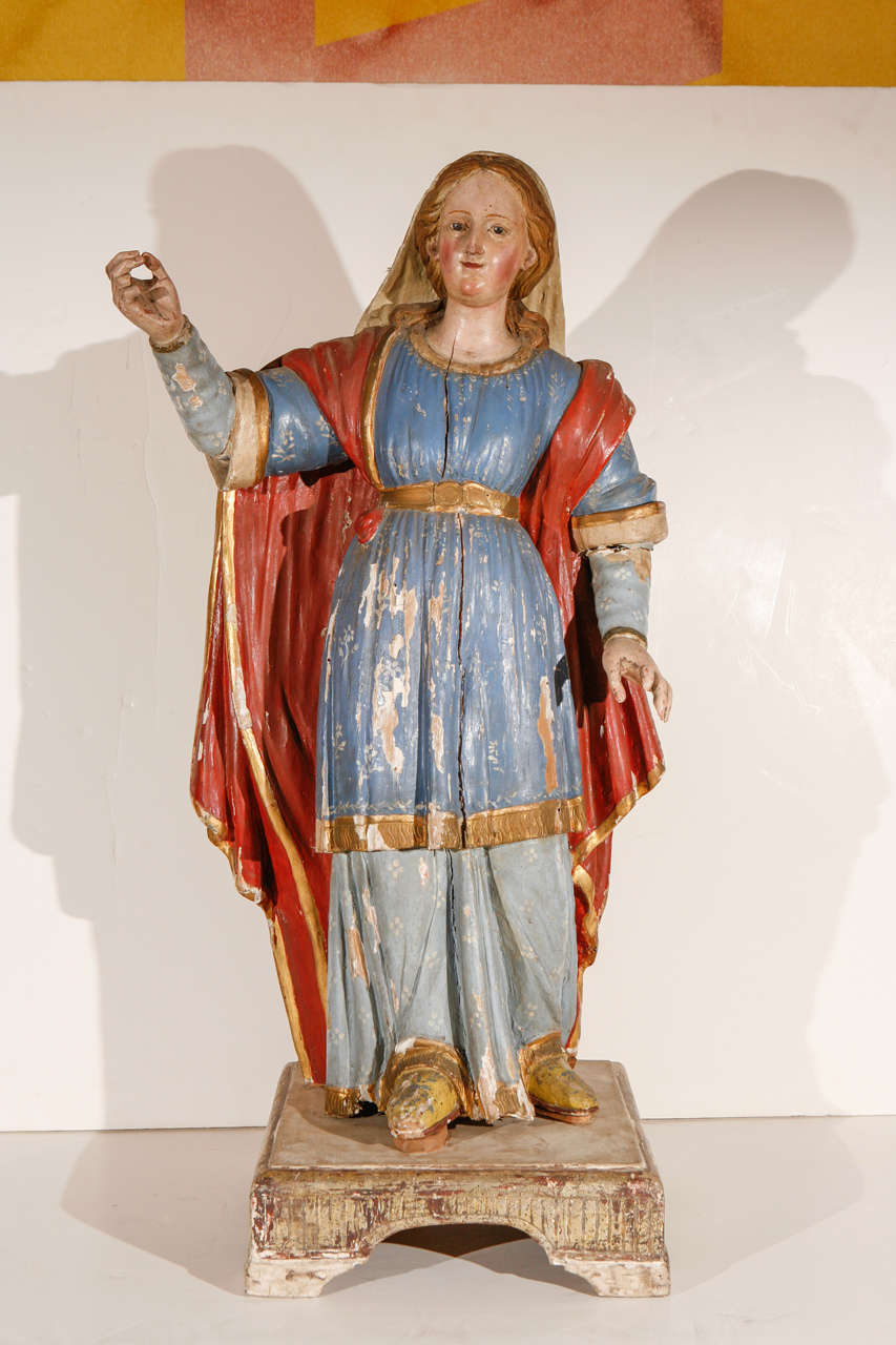 Hand-painted, parcel-gilt, wood statue of the Virgin Mary mounted on a circa 1725, old-wood base.