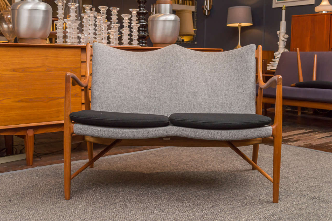 Extremely rare Finn Juhl design NV45 teak settee. Excellent original wood finish, newly upholstered in Danish wool. 