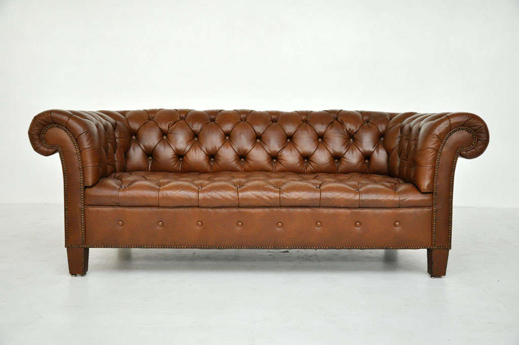 Attirant Brown Leather Chesterfield Sofa By Baker.