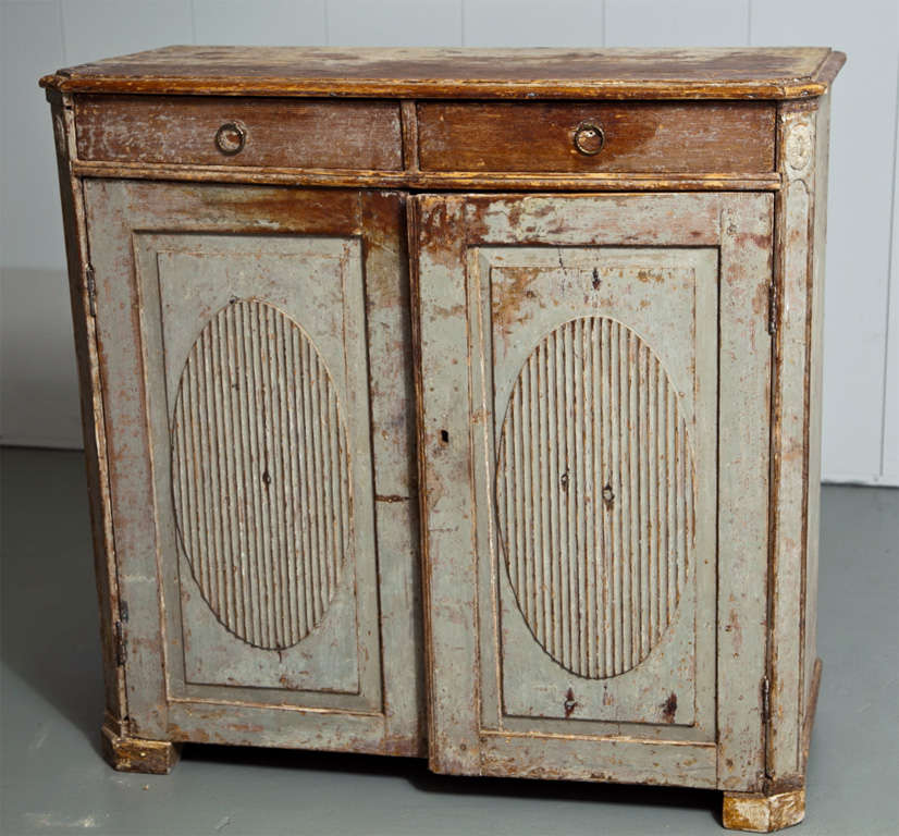 Classic Swedish Gustavian sideboard with lovely pale blue gray original paint. Carved oval designs adorn the front of the doors. Original keys included.