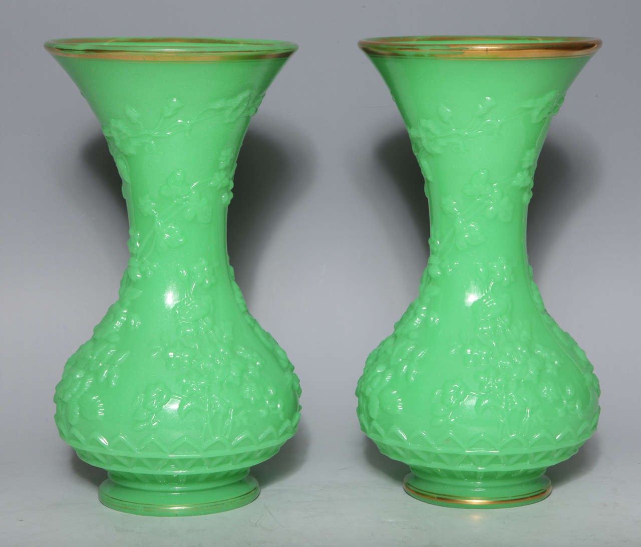 """A fine pair of antique French baluster shaped green opaline glass vases, finely modeled with repose leaves and flowers;  attributed to """"Baccarat"""" French circa 1860"""