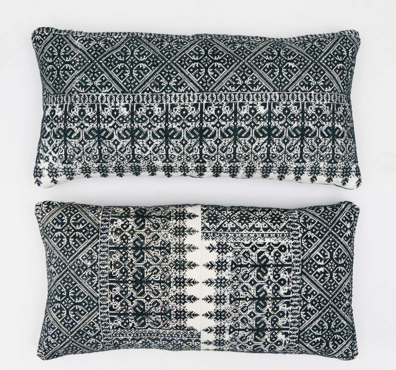 Antique Moroccan textiles from the city of Fez. Intricate all-over silk floss on cotton embroidery produces a durable fabric. Bottom image is made up of two panels sewn in the middel. The designs are based on centuries old Mehindi (henna hand