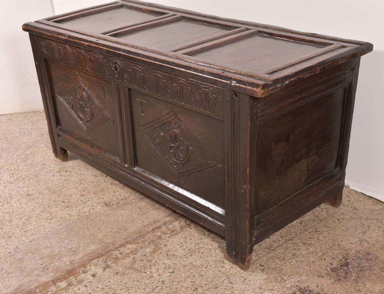 Early English oak chest, joined English paneled coffer, or chest, constructed in the late 17th or early 18th century. Used to store and protect a household's fine linens, clothing and valuables. This chest features carved nulling across the top of
