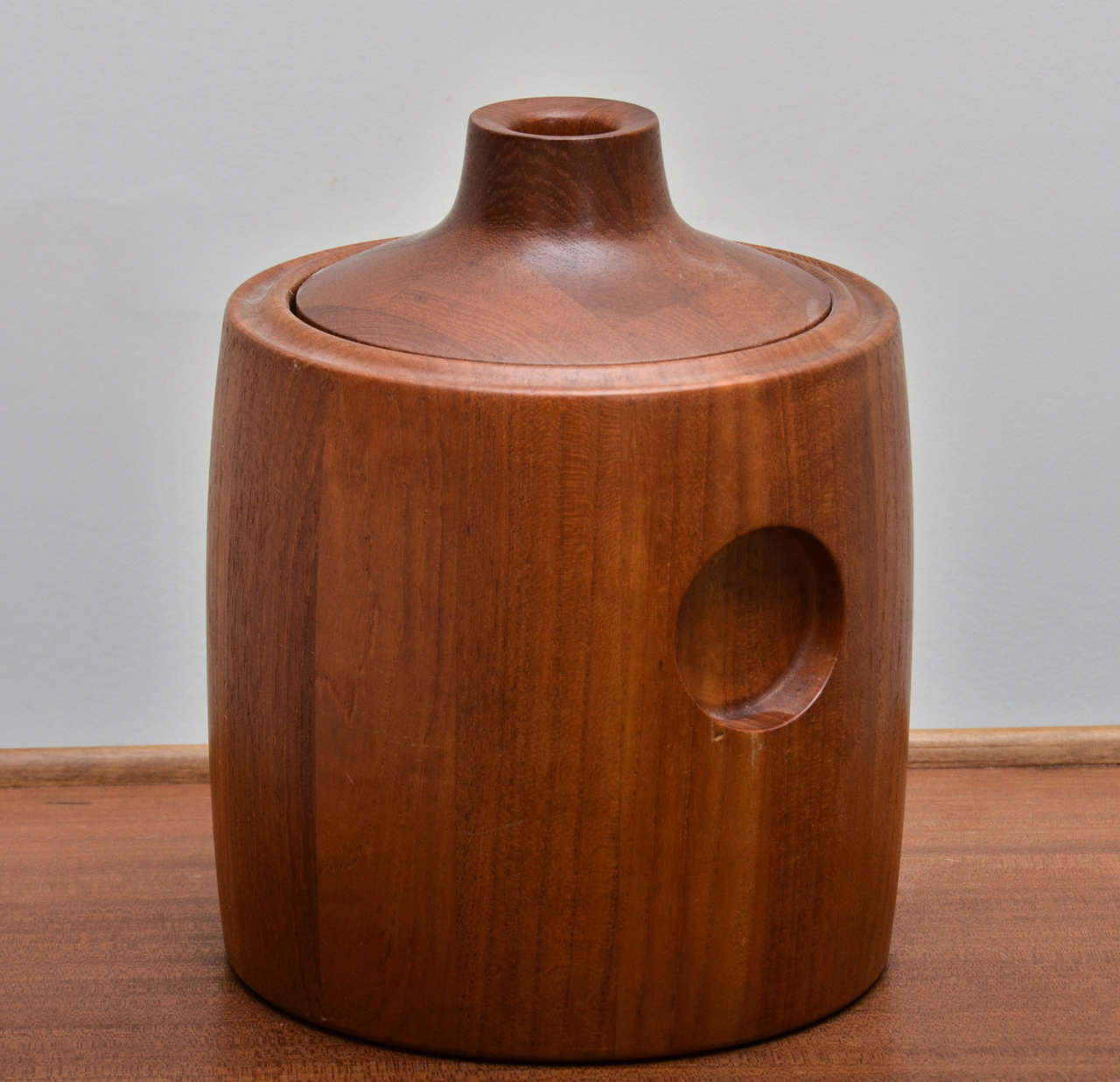 Mid century teak ice bucket with removable lid and plastic lined + Insulated interior. Signed  and stamped on bottom by GT Jensen, Denmark.